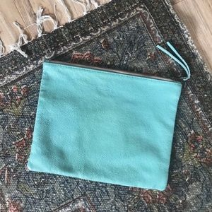Urban Outfitters turquoise clutch